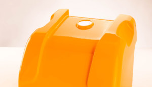 Orange plastic part that was deepdrawn